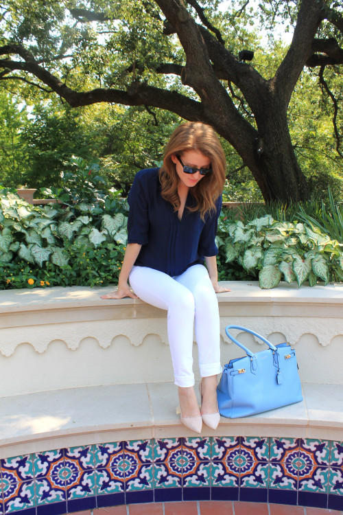 navy silk top white jeans blue bag