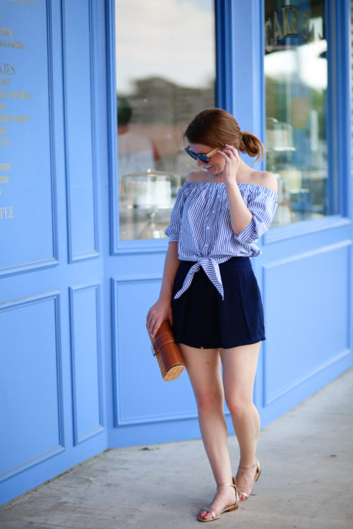 A preppy summer outfit on Design Darling featuring a striped off-the-shoulder top, wicker clutch, and pineapple sandals