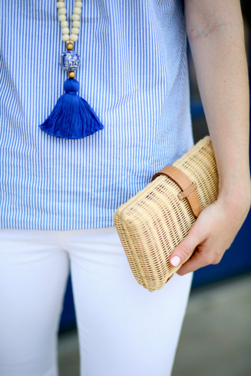 Design Darling Cricket blue tassel necklace, Tuckernuck seersucker top, and J.Crew rattan clutch