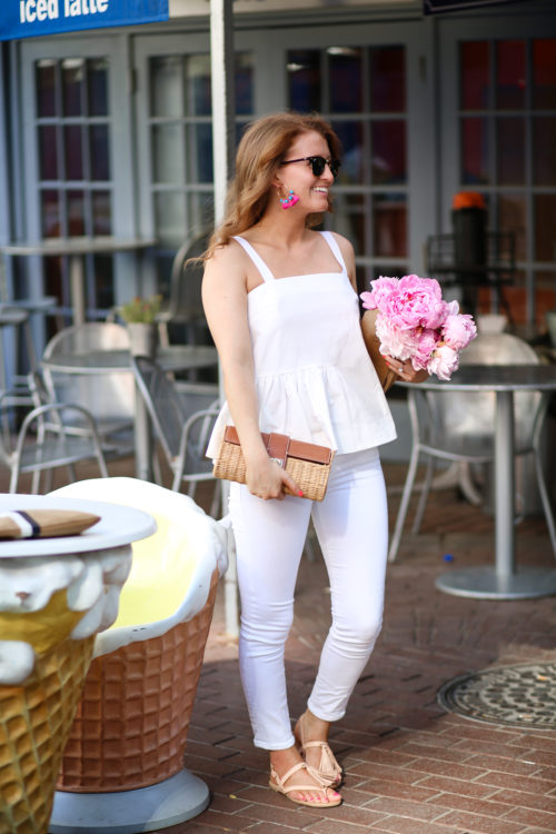 Design Darling wears a Topshop peplum top, J.Brand white skinny jeans, and Kate Spade tassel sandals