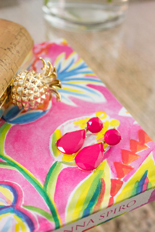 Hot pink drop earrings and cork pineapple clutch from Charming Charlie