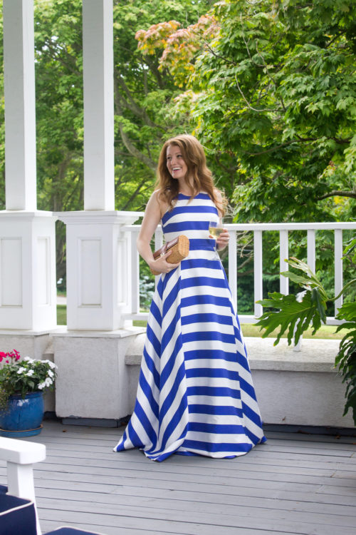 design darling wears a blue and white striped gown from tuckernuck