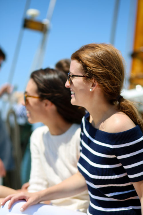 mackenzie horan wears the club monaco zephine sweater while sailing on nantucket
