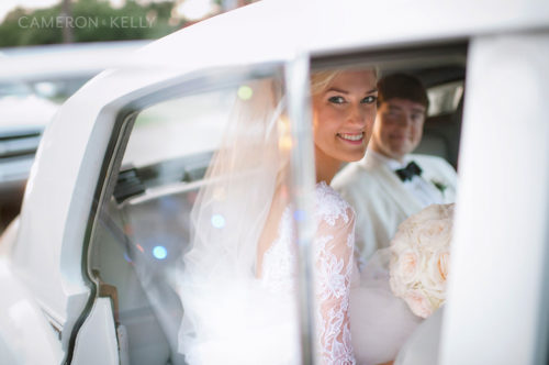 bride in car shot by cameron & kelly studio