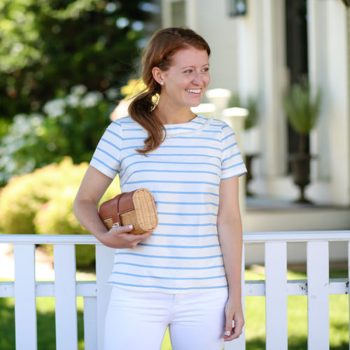 design darling in a devon baer striped top from tuckernuck and wicker clutch from j.mclaughlin