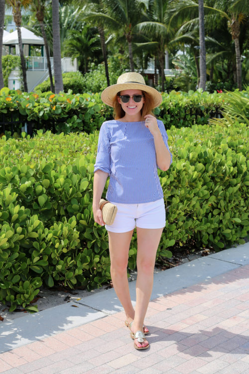 design darling wears a pixie market backless bow top with j.crew white denim shorts and platinum jack rogers