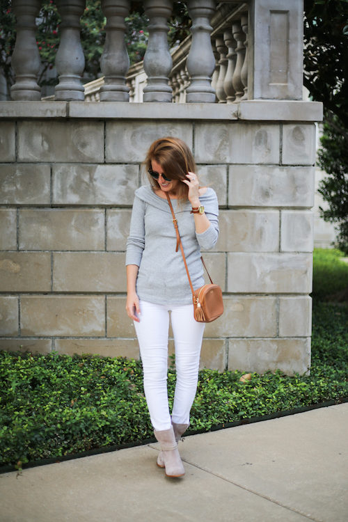 design darling wears a splendid thermal off shoulder top with white skinny jeans and taupe suede booties