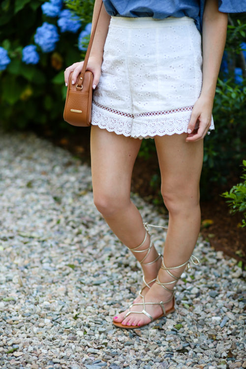 design darling wears endless rose eyelet shorts and steve madden werkit sandals