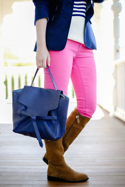 hot-pink-jeans-and-tory-burch-riding-boots-on-design-darling