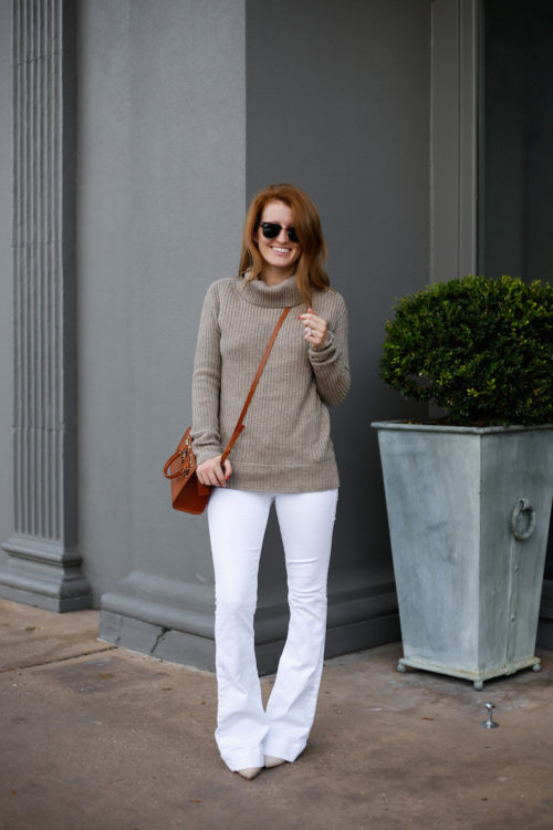 tan-sweater-and-white-flared-jeans-on-design-darling