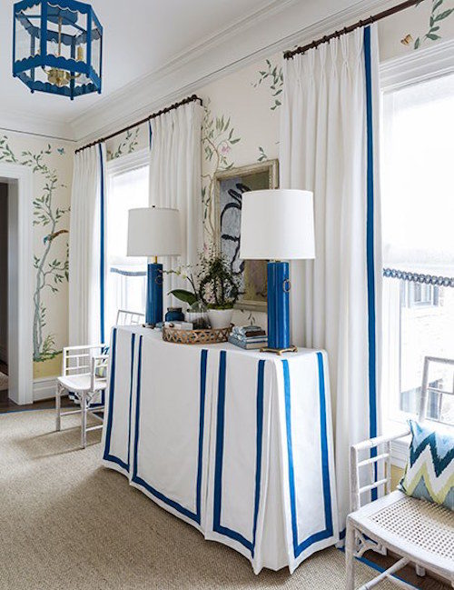 white-curtains-with-blue-trim-skirted-table