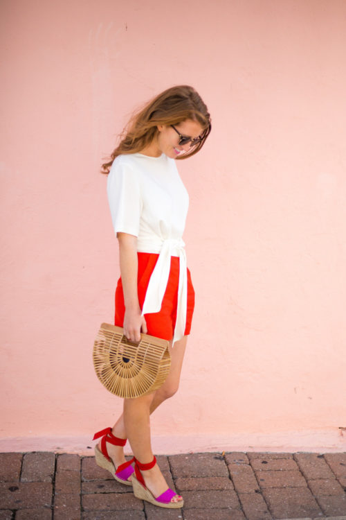 pink-and-red-outfit-inspiration-club-monaco-bow-top-with-red-shorts-and-pink-and-red-espadrilles
