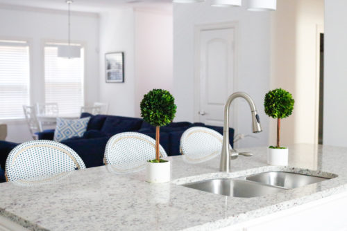 design-darling-home-tour-serena-and-lily-riviera-barstools-and-boxwood-topiaries