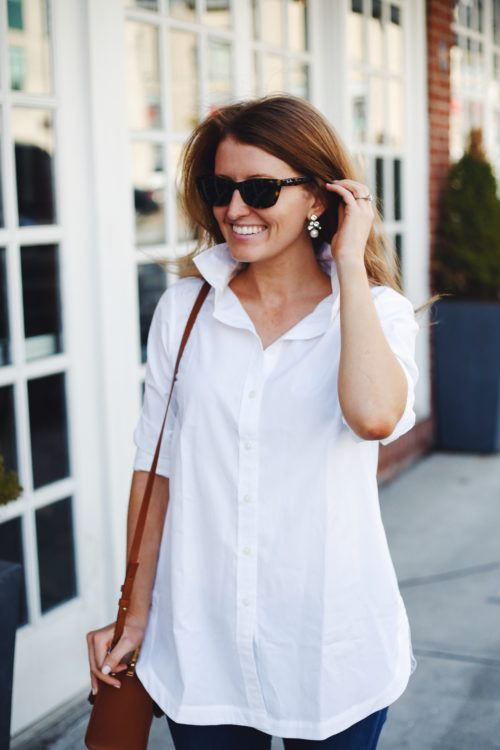 pearl earrings and white button down tunic on design darling