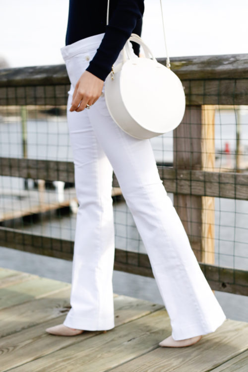 white sailor jeans from banana republic with white circle bag from clare v on design darling