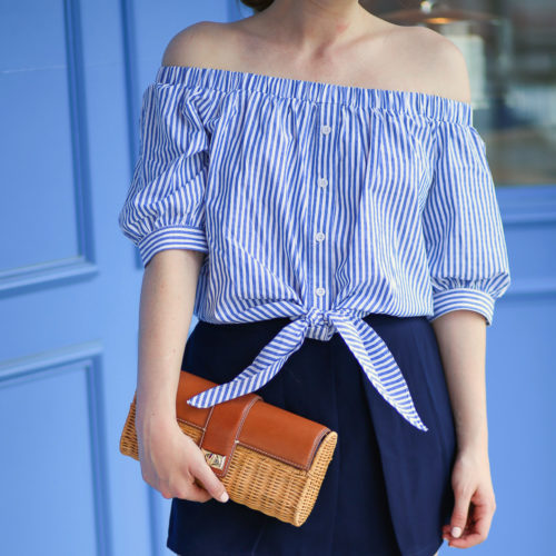 A-striped-off-the-shoulder-top-from-Tuckernuck-paired-with-a-wicker-clutch-from-J.McLaughlin