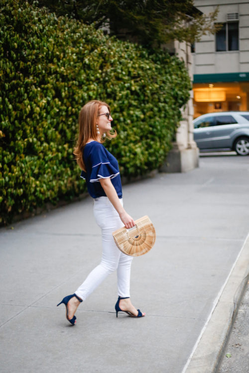 design darling wearing sail to sable navy top j brand white skinny jeans and cult gaia ark bag