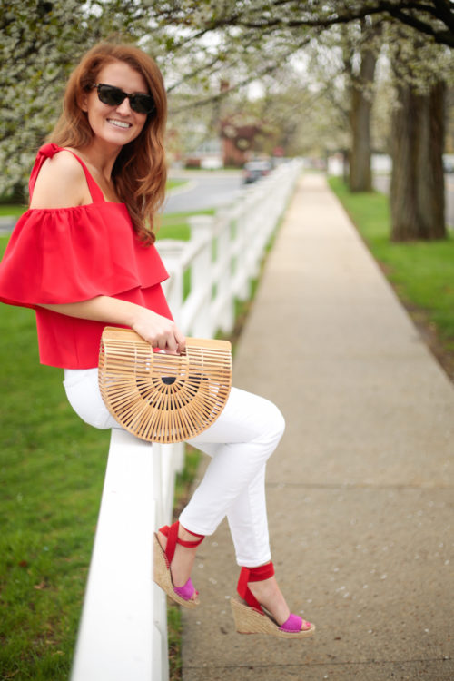 amanda uprichard eli top in lipstick red with cult gaia small ark bag and loeffler randall wedge espadrilles in red and pink