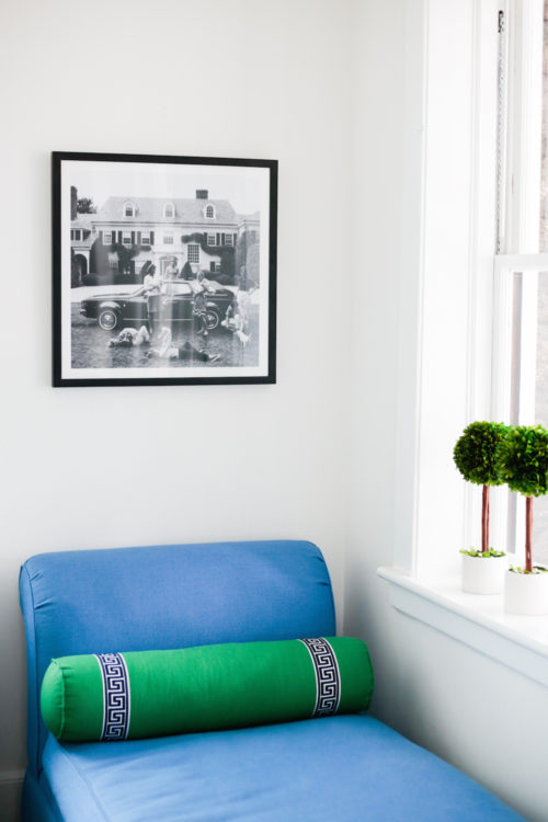 black and white slim aarons print with blue chaise longue and green greek key bolster pillow on design darling