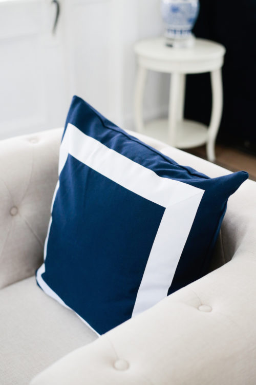 navy pillow with white grosgrain trim from etsy on design darling
