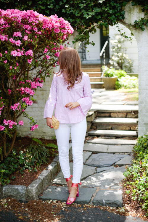 J.Crew lookout high-rise crop jean in white, J.McLaughlin natural bamboo clutch, and J.Crew satin colorblock sandals with ankle wraps on Design Darling