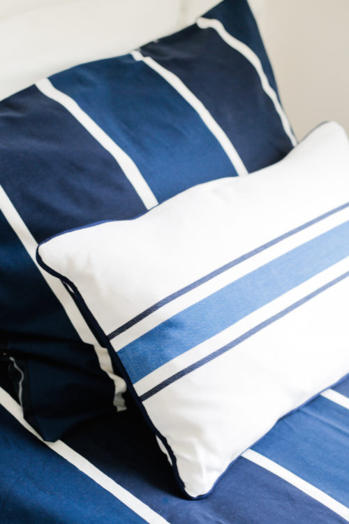 design darling nantucket guest bedroom striped pillows