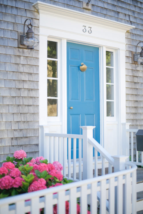 nantucket turquoise door with gold shell knocker with pink hydrangeas