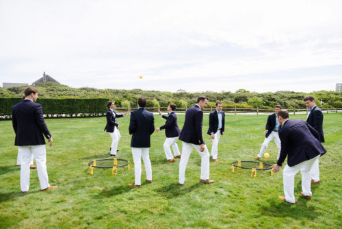 design darling groomsmen playing spikeball
