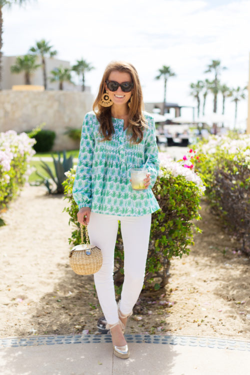 celine caty sunglasses tuckernuck raffia earrings persifor palm print top frances valentine honey pot straw bag j.crew lookout high-rise jean in white and soludos gold wedge espadrilles
