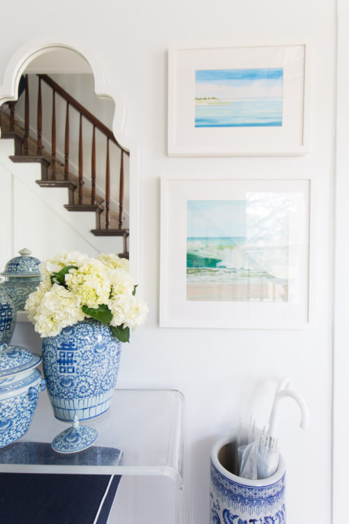 design darling foyer with acrylic console