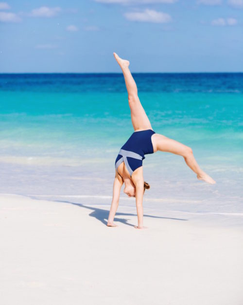 vineyard vines stripe one piece on design darling handstand on beach in bahamas