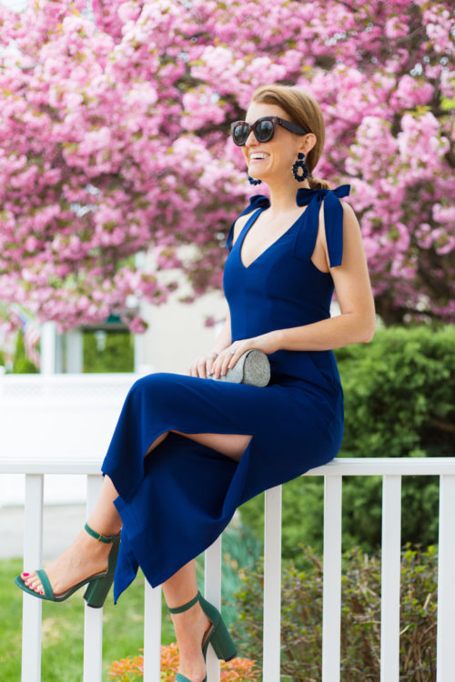 navy bow shoulder jumpsuit and stuart weitzman nudist sandals evergreen