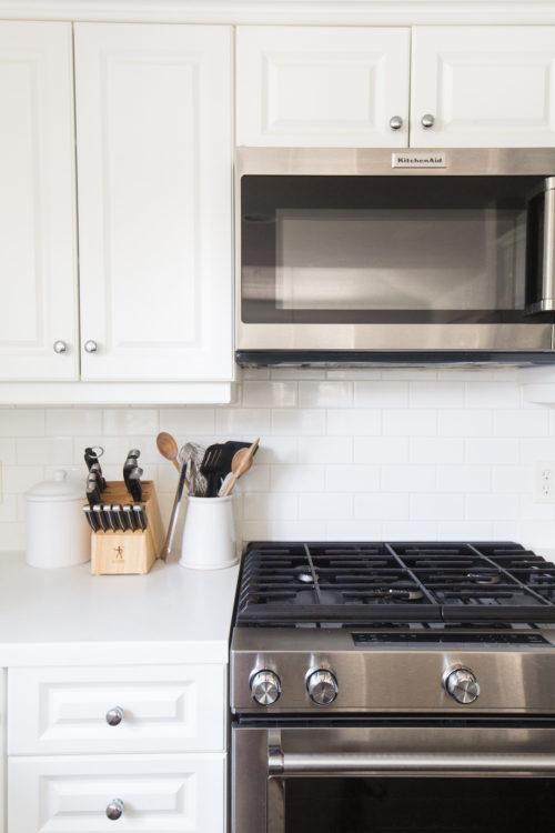 kitchenaid stainless steel microwave with white subway tile kitchen